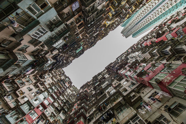 """One of the best look-up spots in Hong Kong. At street level there are shops and on top, lots of small apartments. Here they recorded the Transformer movie """"Age of Extinction"""" Apartment Architecture Balcony Building Building Exterior Built Structure Composition Hong Kong Human Settlement Outdoors Perspective Residential District Residential Structure Towards The Sky Market Bestsellers May 2016 Bestsellers"""