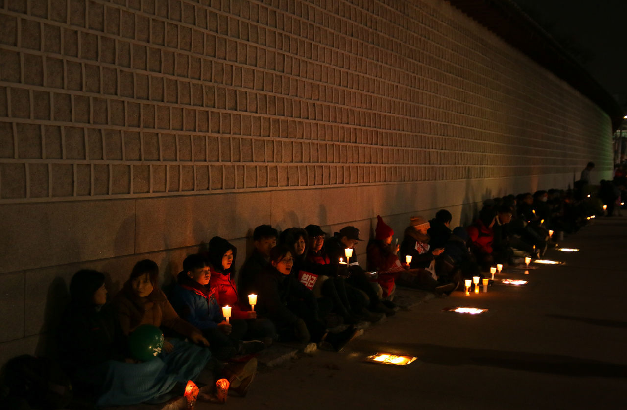 Seoul, South Korea - December 3, 2016: Hundreds of thousands of people gathered at a rally for 6th time with candle lights on their hands to call for the impeachment of President Park Geun-hye. Candle Candle Light Citizen Corruption Crow Demo Demonstration Government Impeachment Korea Night Ouster People Political President Rally Scandal Seoul