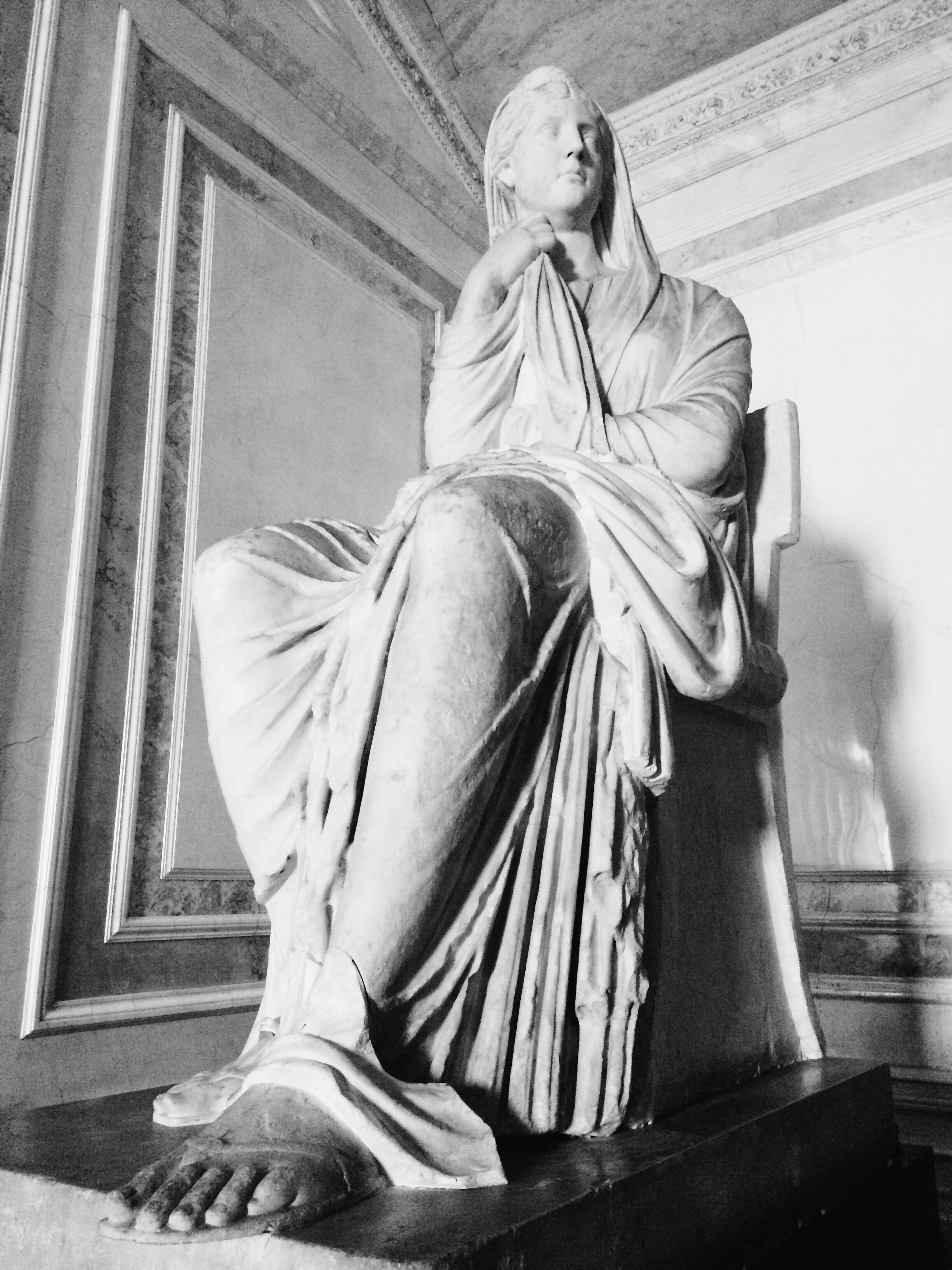 statue, human representation, sculpture, art and craft, low angle view, art, memories, creativity