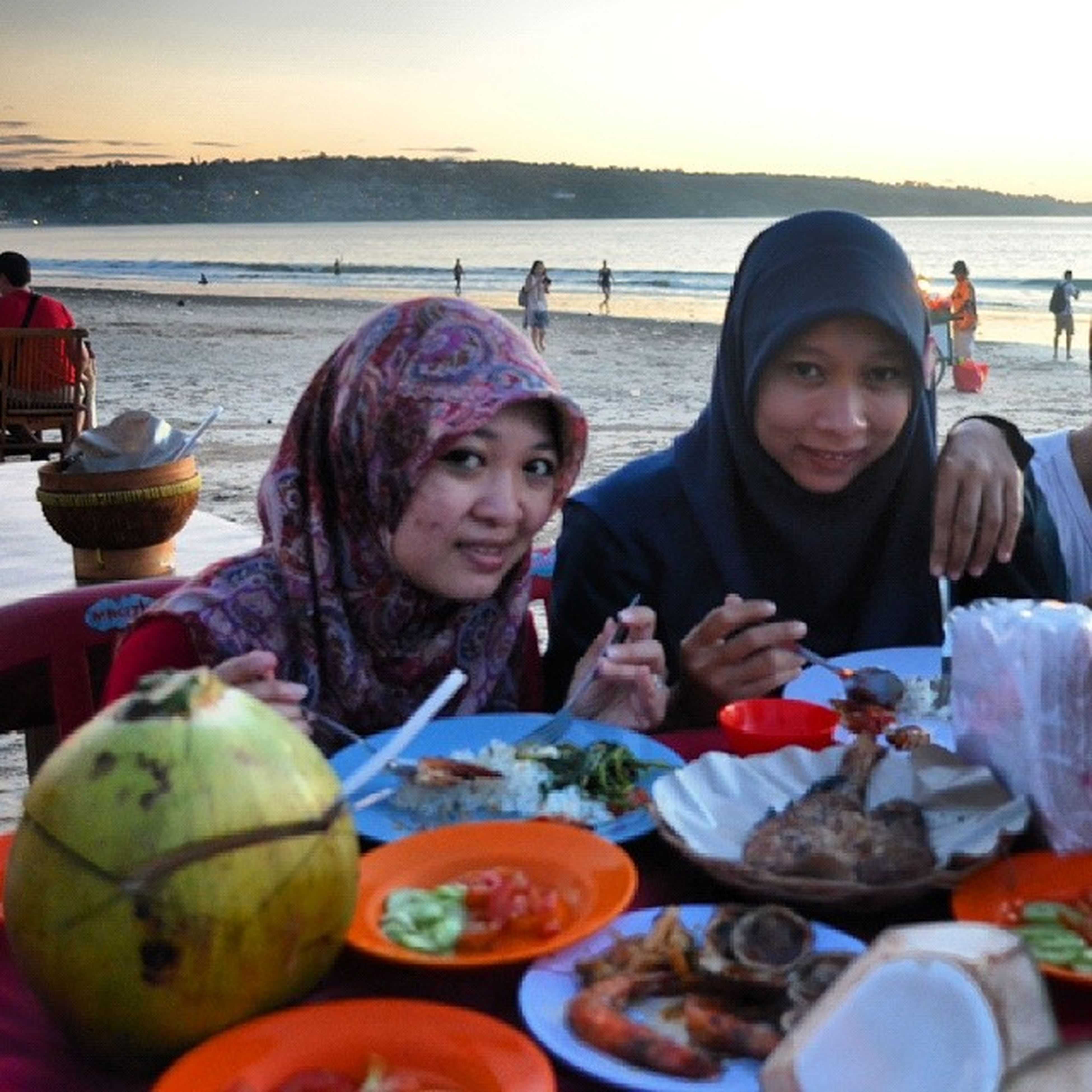 lifestyles, food and drink, leisure activity, person, portrait, happiness, looking at camera, food, smiling, togetherness, front view, casual clothing, enjoyment, bonding, sea, water, young adult