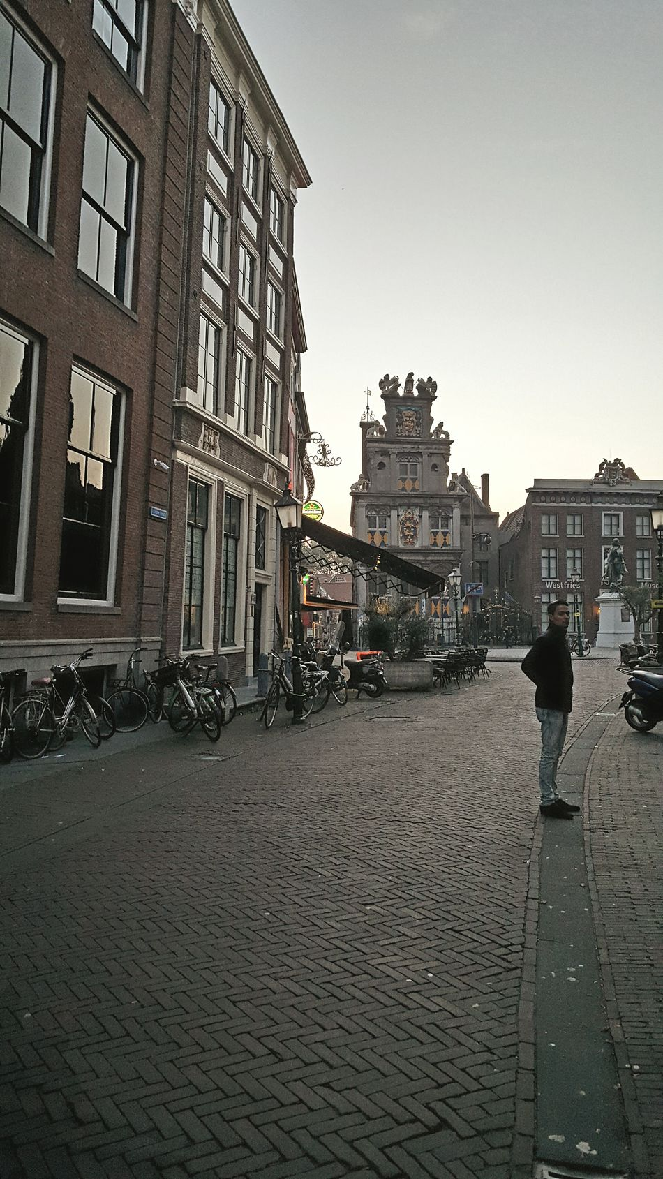 City Travel Destinations Street Architecture Building Exterior One Man Only Outdoors One Person Exploring New Ground Autumn Old Buildings Dutch Architecture Dutch House Hoorn, Netherlands Netherlands Architecture_collection Taking Pictures Hoorn Old Town Taking Photos Dutch Cities Walking City History Cityscape