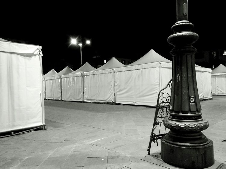 Blancoynegro Tuscany Tents Market Place No People Night Outdoors Iron Bed chain Darkness And Light square Tranquil Scene