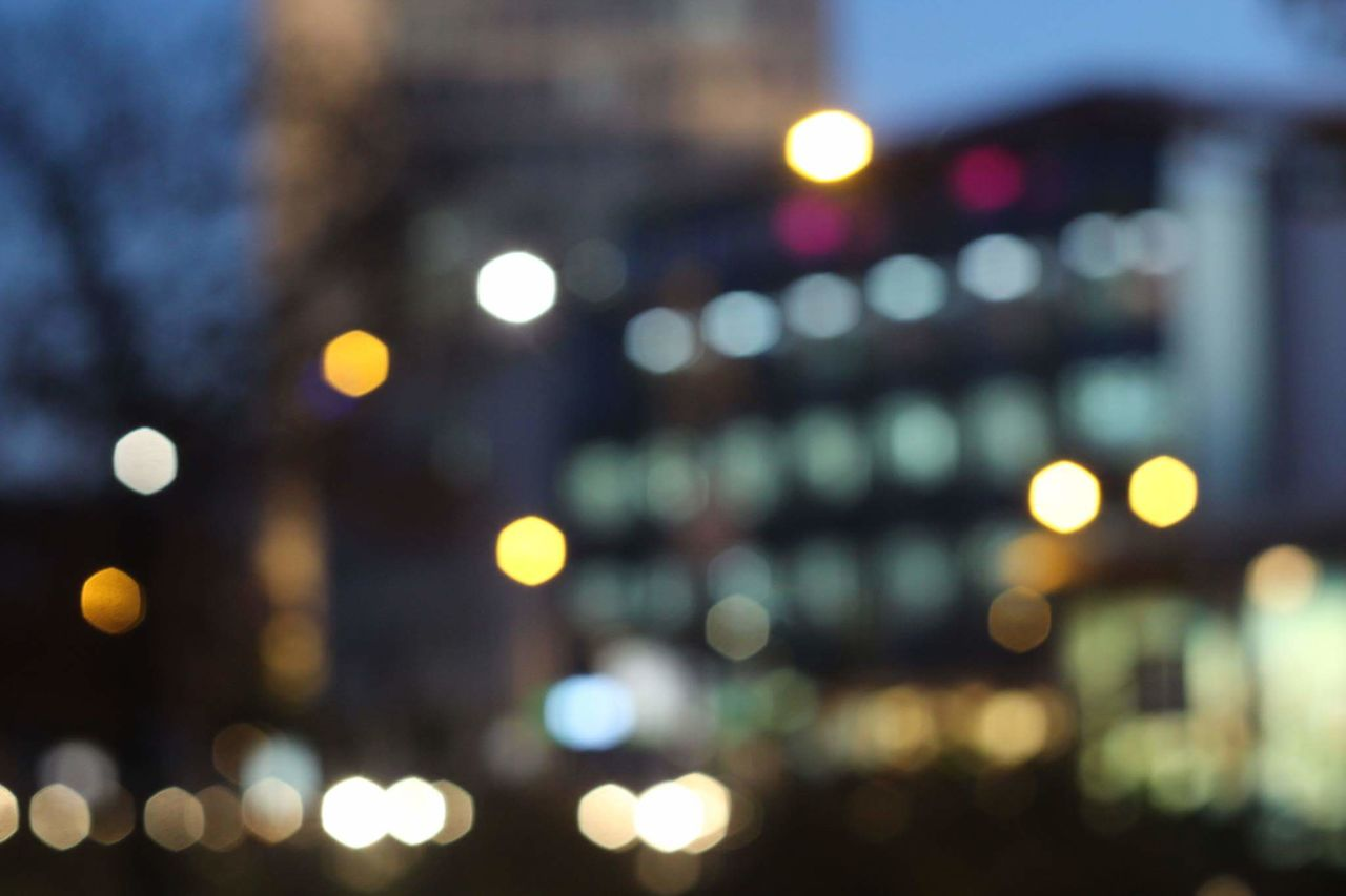 illuminated, night, glowing, lens flare, lighting equipment, defocused, no people, outdoors, city, architecture, close-up