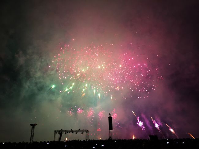 Arts Culture And Entertainment Celebration Entertainment Event Exploding Firework - Man Made Object Firework Display Glowing Illuminated Long Exposure Low Angle View Motion Multi Colored Night No People Outdoors Pink Color Red Sky Sparks Vibrant Color