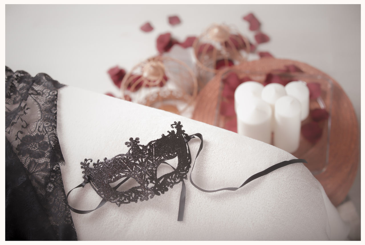 indoors, table, close-up, one person, ribbon, real people, white background, food, day, freshness