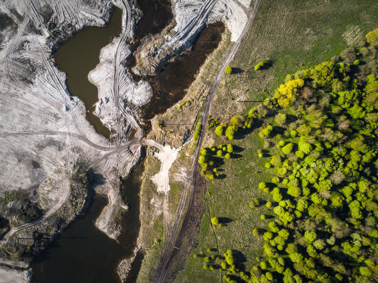 Two Worlds - Big contrast on planet Earth Barrier Beauty In Nature Bird Eyes View Contrast Contrasting Colors Dji Drone  Dronephotography Dunes Earth Forest Forest Photography High Angle View Lake Lakes  Landscape Mavic Mavic Pro Nature Physical Geography Quarry Sand Scenics Tree Twoworlds