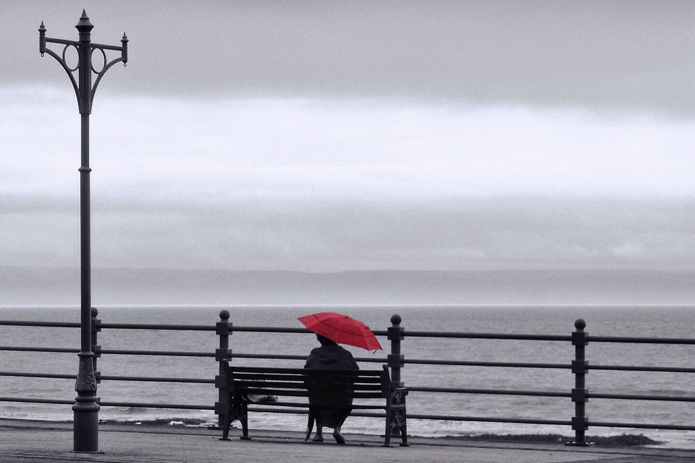 Sitting in the rain. Wales Rain Red