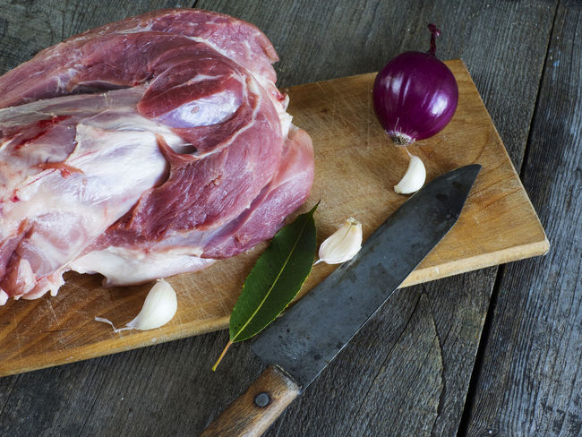 raw pork shank on cutting board on old weathered wooden background Background Close-up Cutting Cutting Board Day Food Food And Drink Freshness High Angle View Indoors  Knife Meat No People Old Pork Raw Ready-to-eat Shank Table Weathered Wooden
