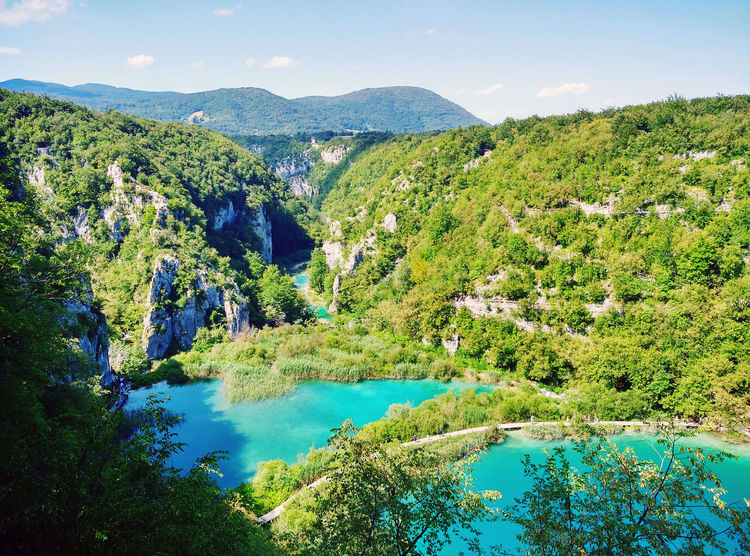 Beauty In Nature Blue Croatia Green Idyllic Lake Landscape Majestic Mountain Nature Non-urban Scene Outdoors Plitvice Lakes National Park Plitvice National Park Scenics Tranquil Scene Tree Water