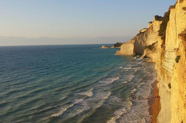 The KIOMI Collection Beachphotography Sunsetbeach Cliffs Cliffview Evening Light Blue Wave