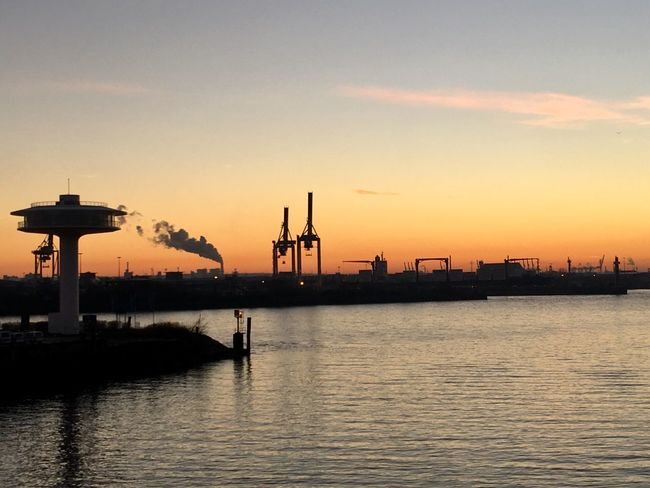 Sunset Water Silhouette Sky Waterfront Orange Color Harbor Built Structure Nature Commercial Dock Beauty In Nature Architecture No People Transportation Tranquility Industry Nautical Vessel