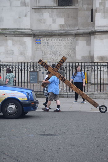 Cross Man City Day Easy Way Outdoors Penitent Real People Transportation