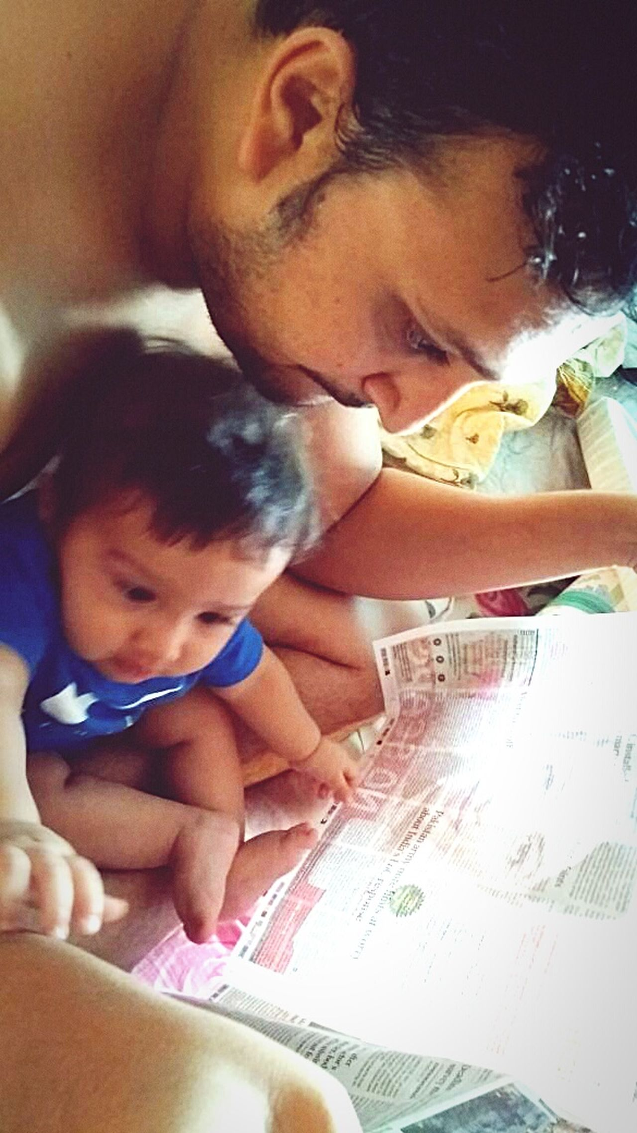 Me and my kid .. newspaper time .. Family With One Child Family Togetherness Baby Indoors  Love Adult Males  Domestic Life Child Females Smiling Childhood Lifestyles Headshot Happiness Cheerful People Newspaper Men The Portraitist - 2017 EyeEm Awards
