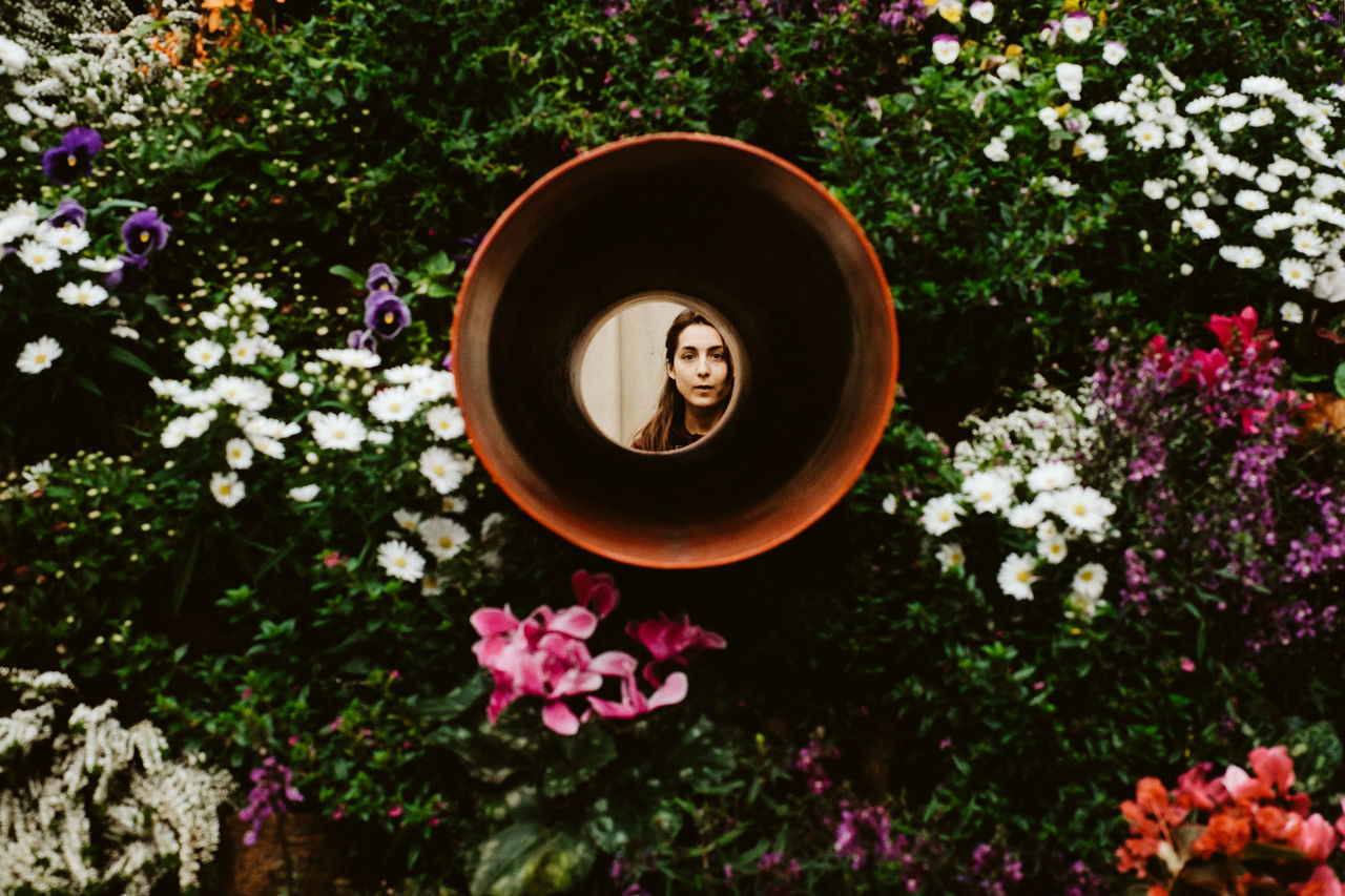 beauty in Nature Circle flower flower head flowers Frame It! Framed Freshness Lady Nature outdoors person Plant Plant plantpot Woman EyeEmNewHere