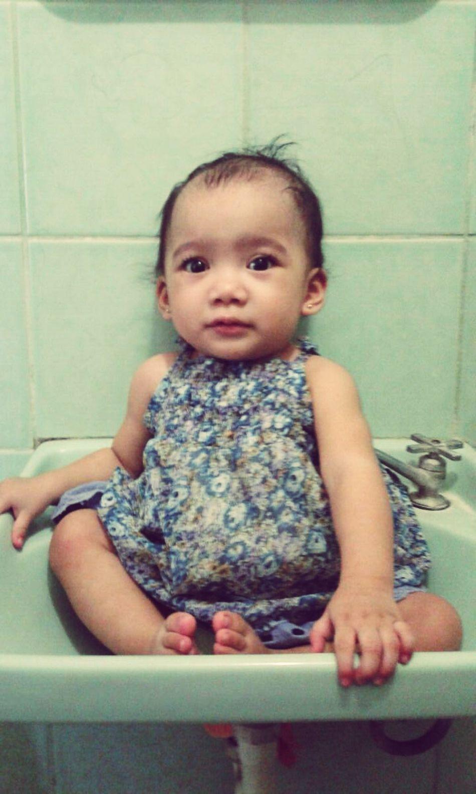 Babygirl Babysitting Baby Sittin Pretty Baby Sitting On The Faucet Over The Faucet Pretty Babygirl Pretty In Dress My Pretty Neice :)