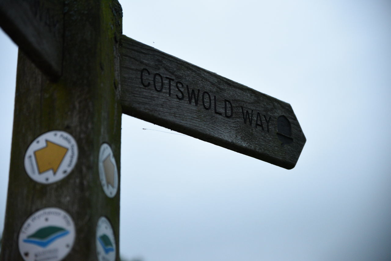 Blue Close-up Cotswold Cotswold Way Cotswolds Day Directional Sign Focus On Foreground Information Information Sign Low Angle View No People Outdoors Pole Road Sign Sky Text Western Script