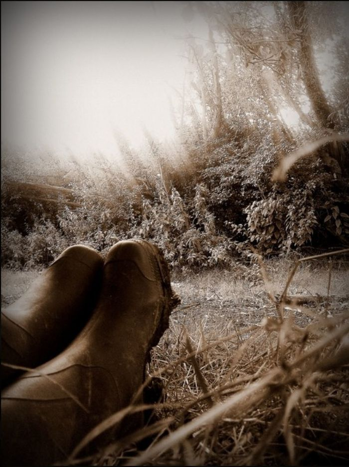 Outdoors Grass wellies Ground Level View sepia