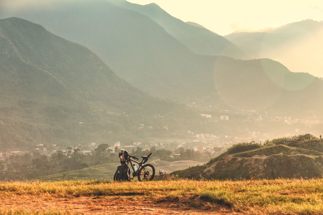 EyeEm Selects Field Mountain One Man Only Tree Agriculture Only Men Adult One Person Adults Only Day People Outdoors Nature Sky Eyeemnepal Retro Shot From Behind Rear View Gazing Hills Hillside Bicycle Ride Rider