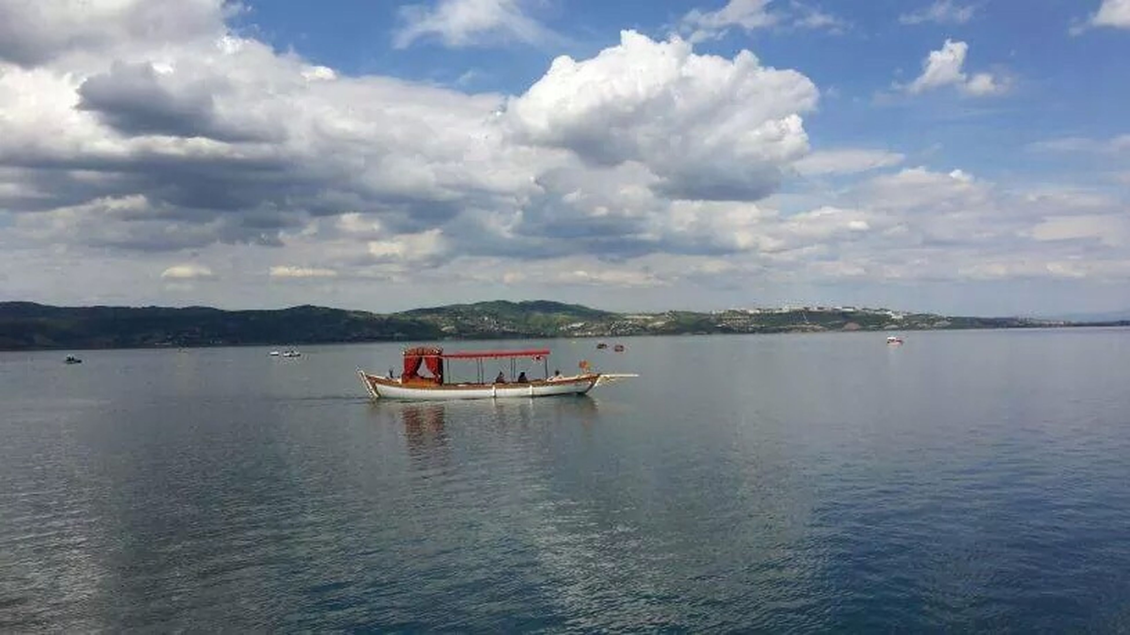 transportation, nautical vessel, water, mode of transport, boat, sky, cloud - sky, waterfront, tranquil scene, tranquility, cloudy, cloud, sea, scenics, beauty in nature, nature, travel, day, moored, outdoors