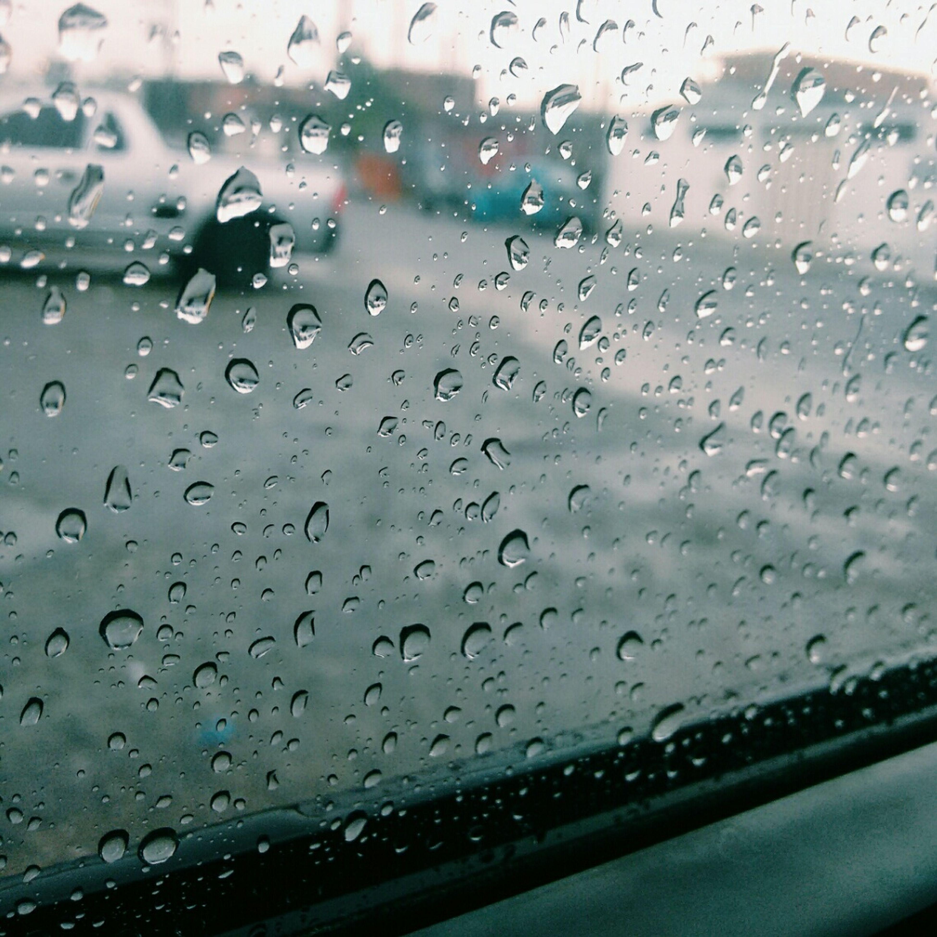 drop, window, wet, transparent, glass - material, transportation, rain, indoors, water, vehicle interior, mode of transport, car, weather, raindrop, season, car interior, windshield, land vehicle, glass, close-up