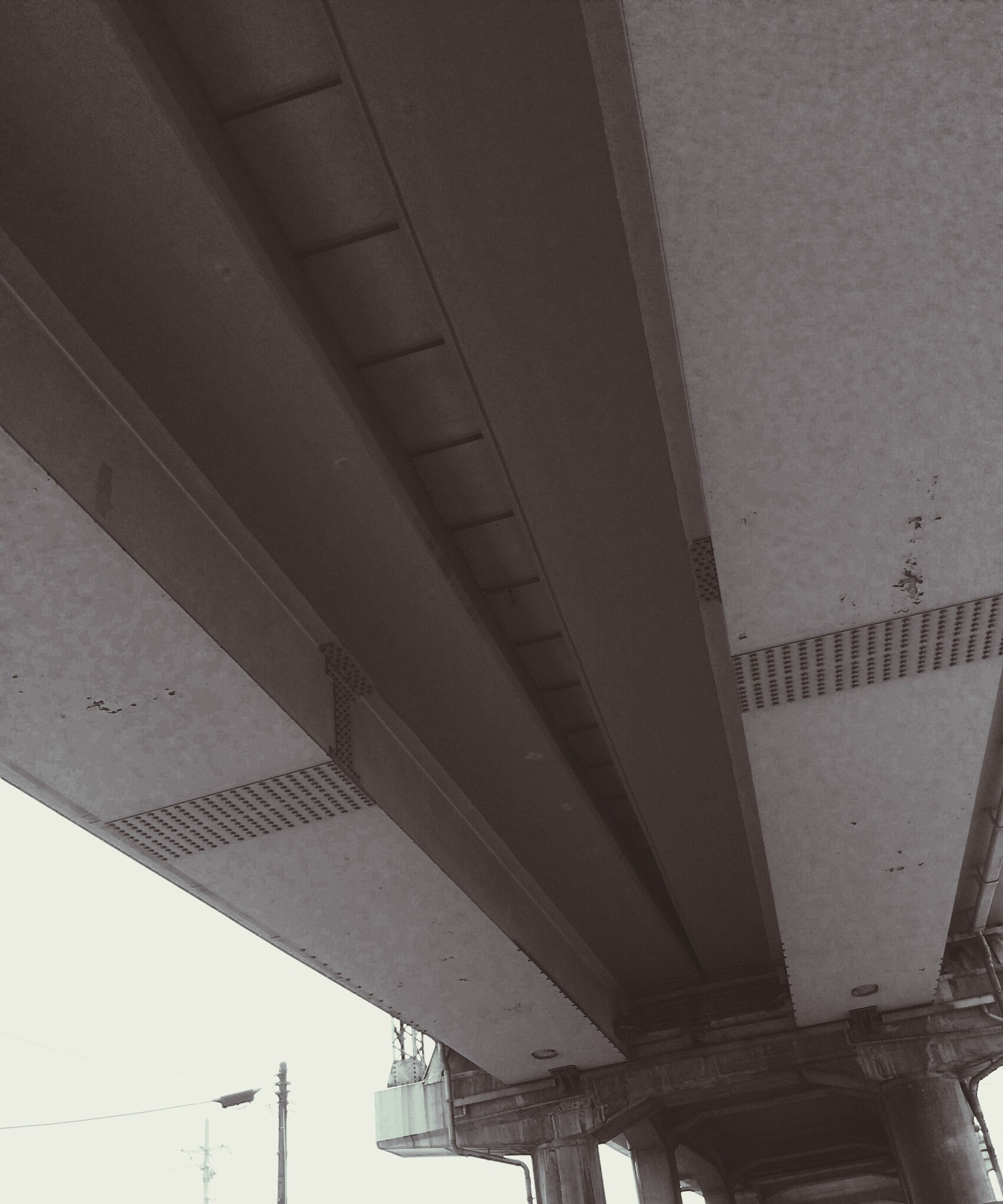 built structure, architecture, low angle view, connection, building exterior, transportation, ceiling, bridge - man made structure, architectural column, day, no people, outdoors, building, engineering, city, sky, modern, clear sky, in a row