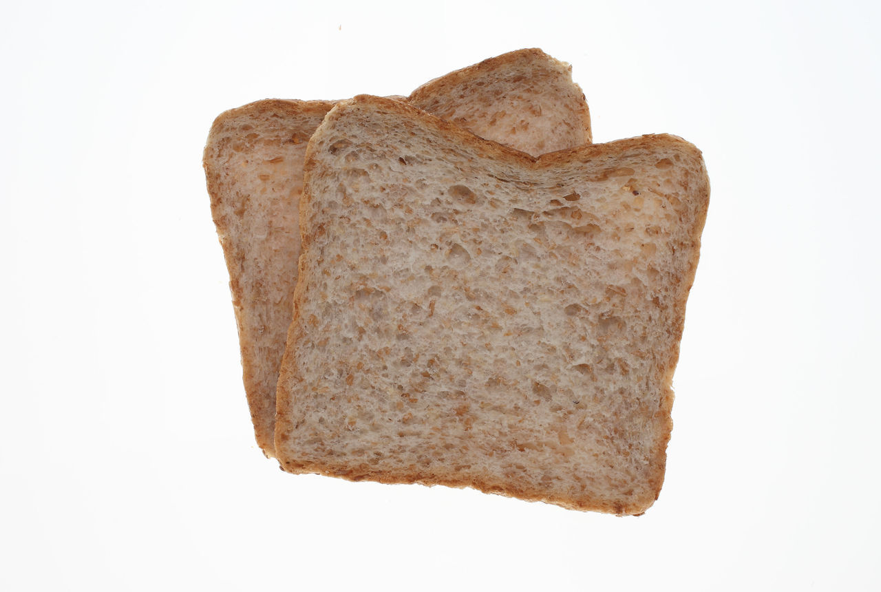 slices of Wholemeal toast bread on white Bread Brown Close-up Cut Out Geometric Shape Heart Shape Indulgence No People Ready-to-eat Romance Single Object Slices Still Life Studio Shot Temptation Toastbread Toast🍞 Toughness White Background Wholemeal Wholemeal Bread