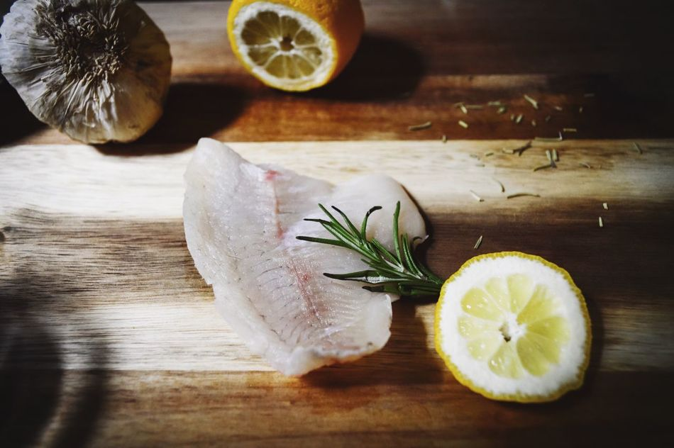 Bluegill fish fillet with lemon and rosemary herb on wood surface Freshness Healthy Eating High Angle View Cutting Board Table Food And Drink Food Fish Fillet Rustic Food Raw Fish Fish Rustic Fillet Raw Meat   Meat Flatlay Flat Lay Fish On Wood Food Photography Rosemary Still Life Food Flat Lays Wood Surface Fresh Ingredients Rustic Style