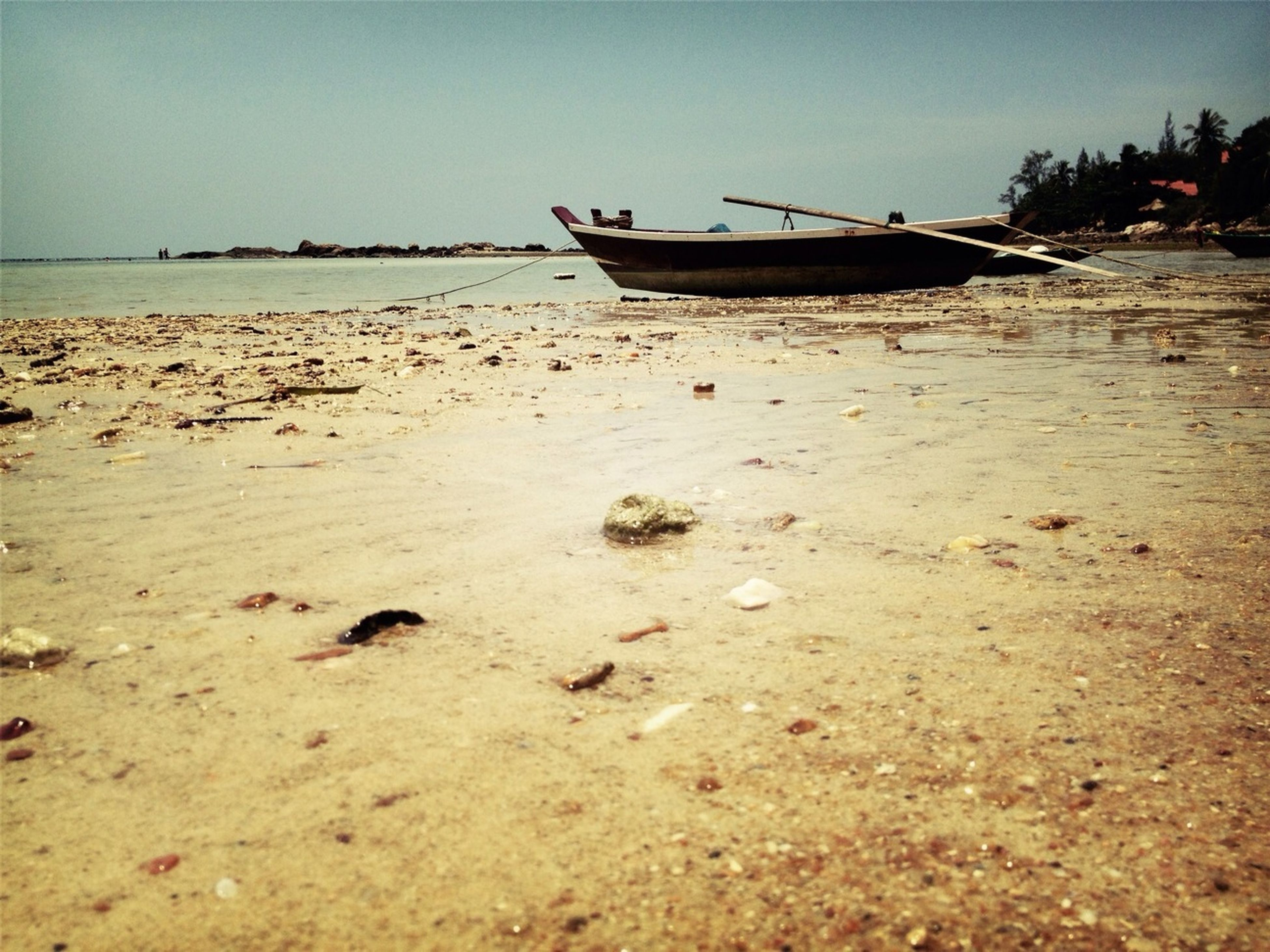 beach, sea, water, nautical vessel, sand, shore, moored, boat, clear sky, horizon over water, transportation, tranquility, mode of transport, tranquil scene, nature, sky, scenics, beauty in nature, outdoors, copy space
