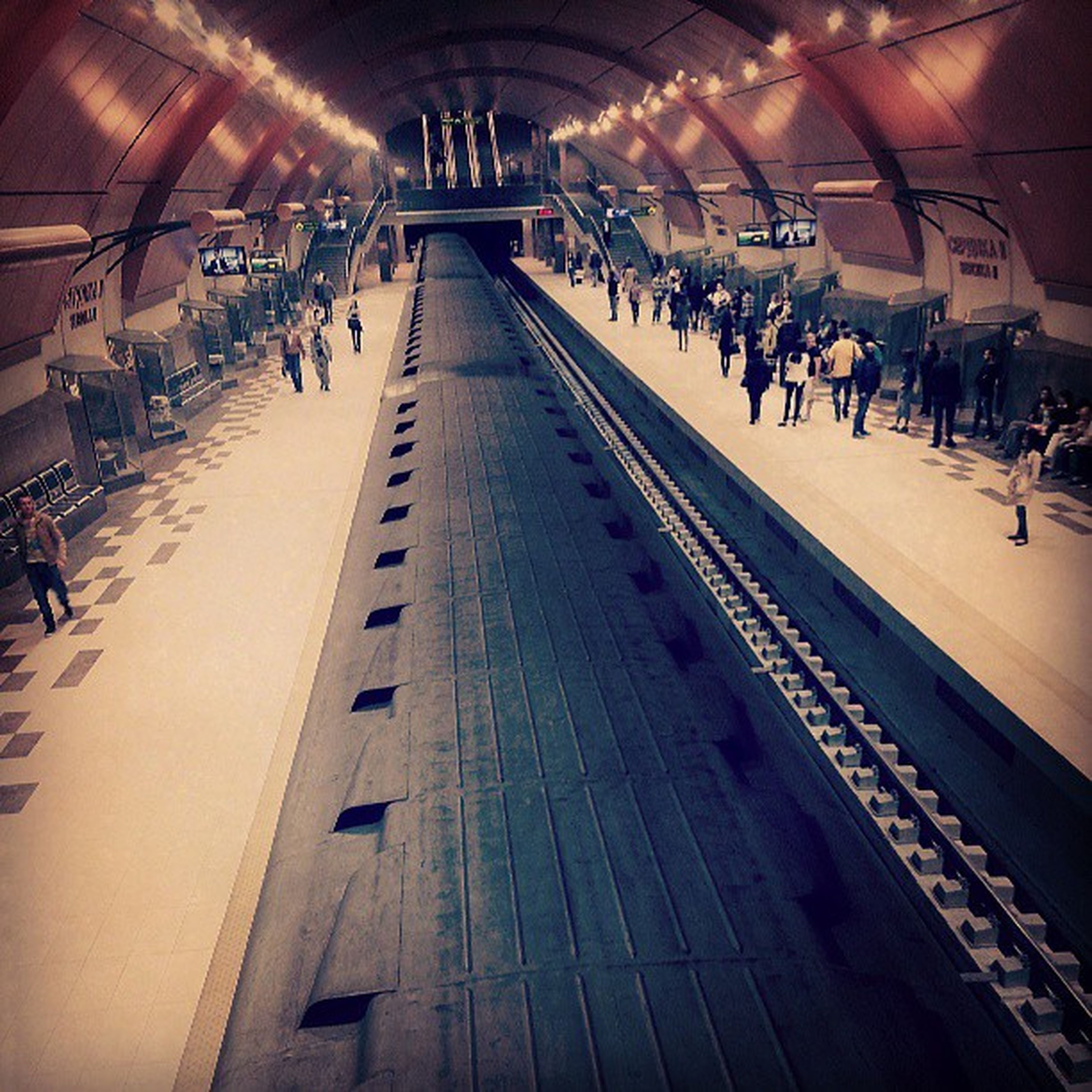 large group of people, indoors, transportation, public transportation, railroad station, illuminated, person, men, architecture, travel, built structure, the way forward, railroad station platform, ceiling, lifestyles, city life, railroad track, rail transportation, incidental people