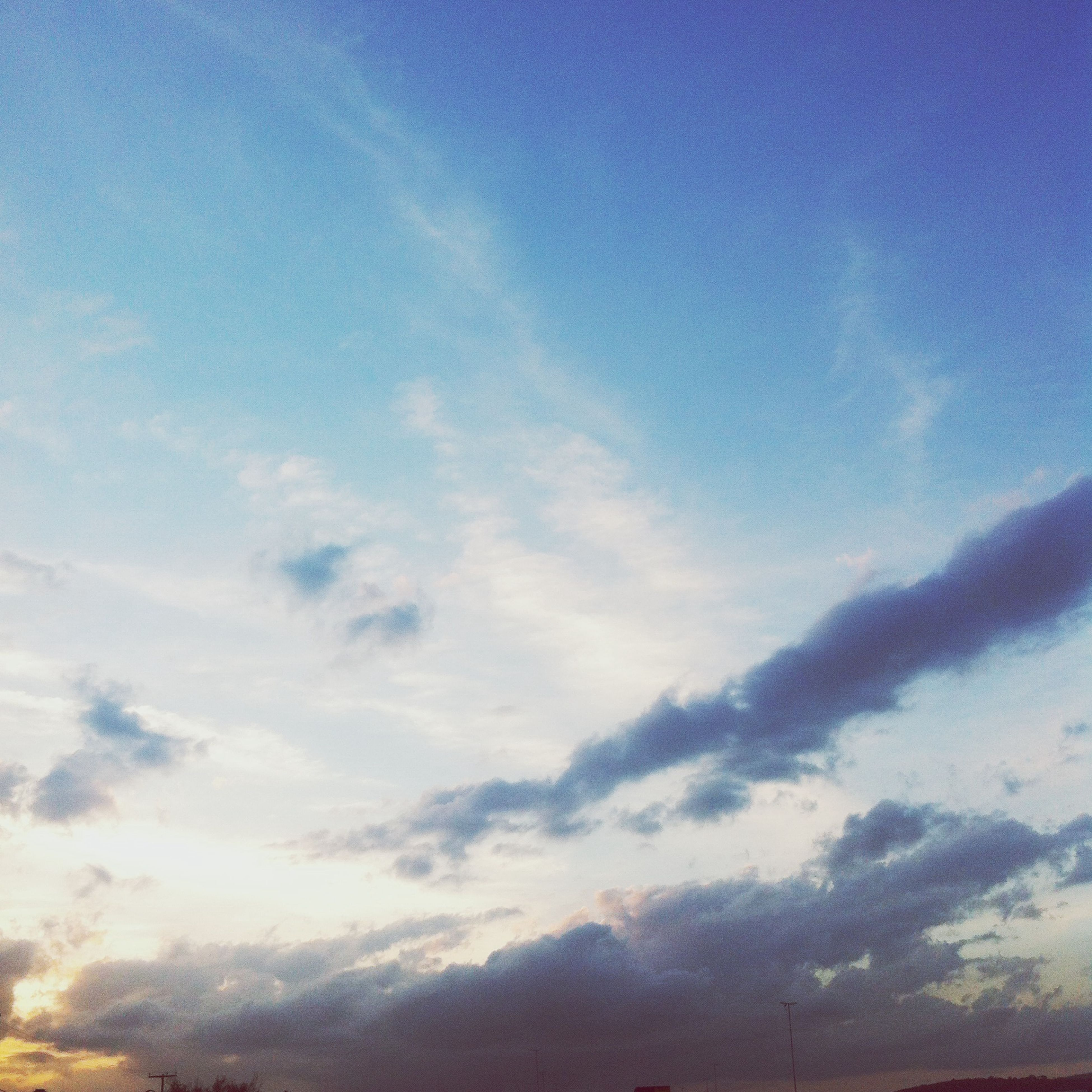 low angle view, sky, blue, cloud - sky, backgrounds, beauty in nature, tranquility, full frame, nature, scenics, sky only, tranquil scene, cloud, cloudy, outdoors, idyllic, no people, day, cloudscape, sunlight