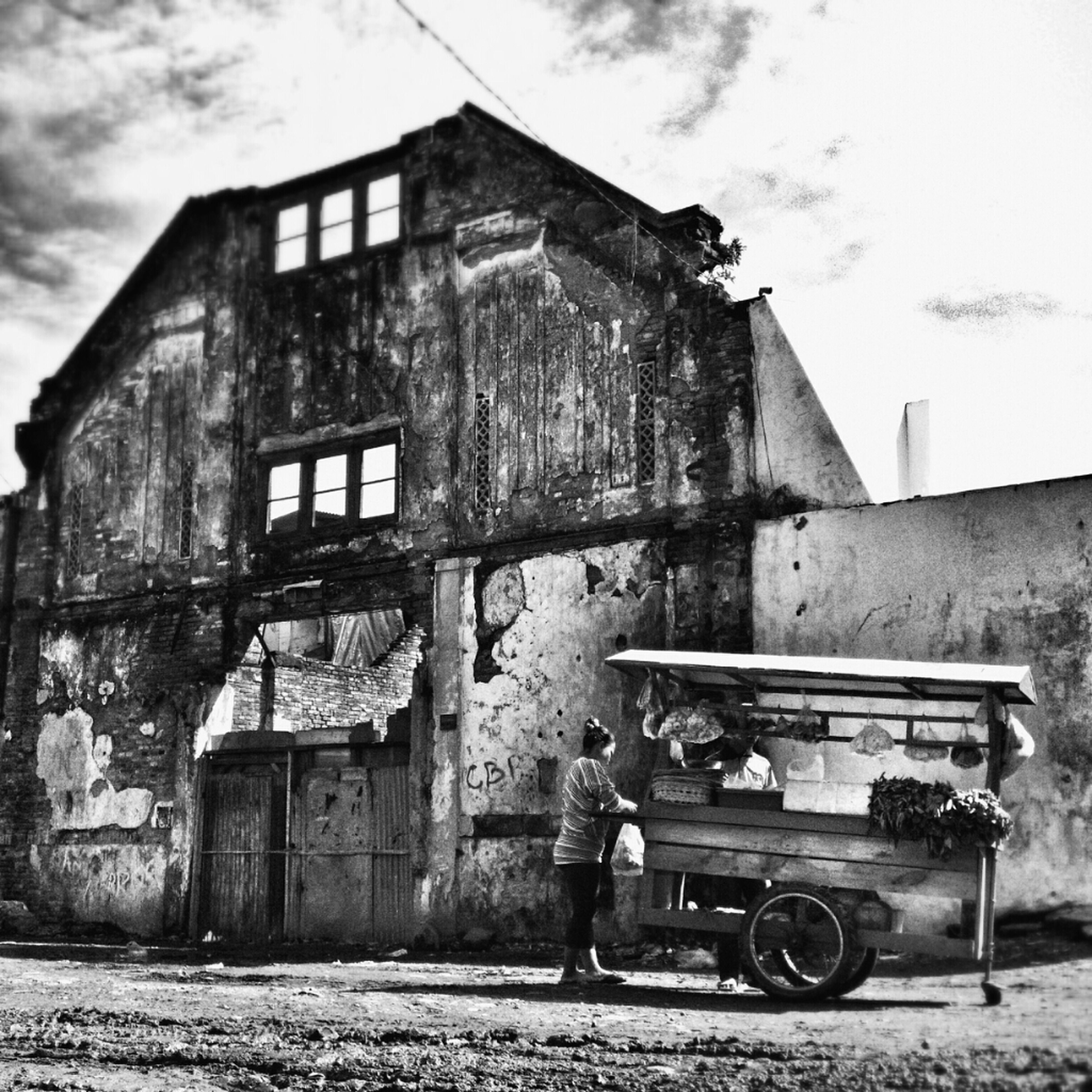 building exterior, architecture, built structure, transportation, sky, abandoned, mode of transport, old, land vehicle, obsolete, house, damaged, deterioration, weathered, run-down, cloud - sky, residential structure, cloud, outdoors, day