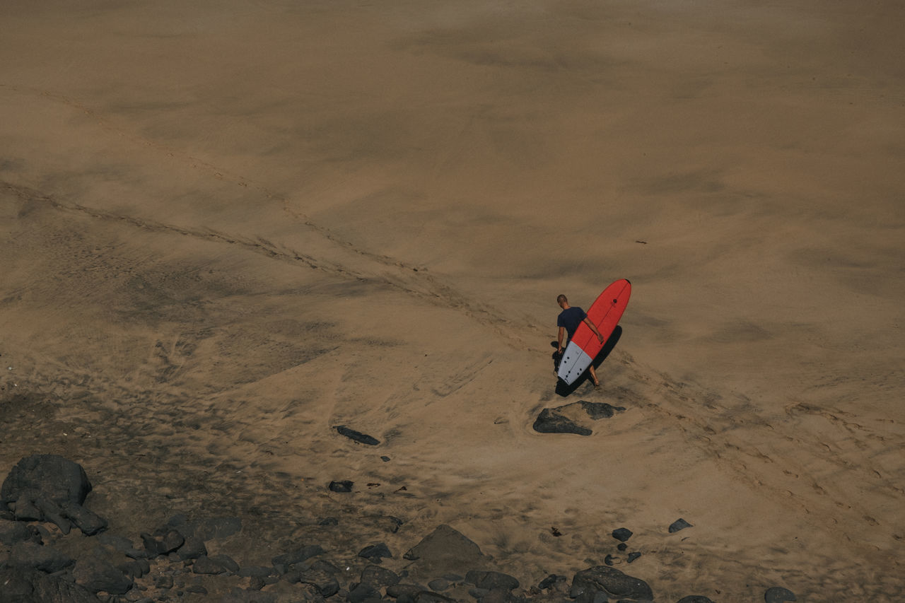 High Angle View Of Man On Sand Dune In Desert