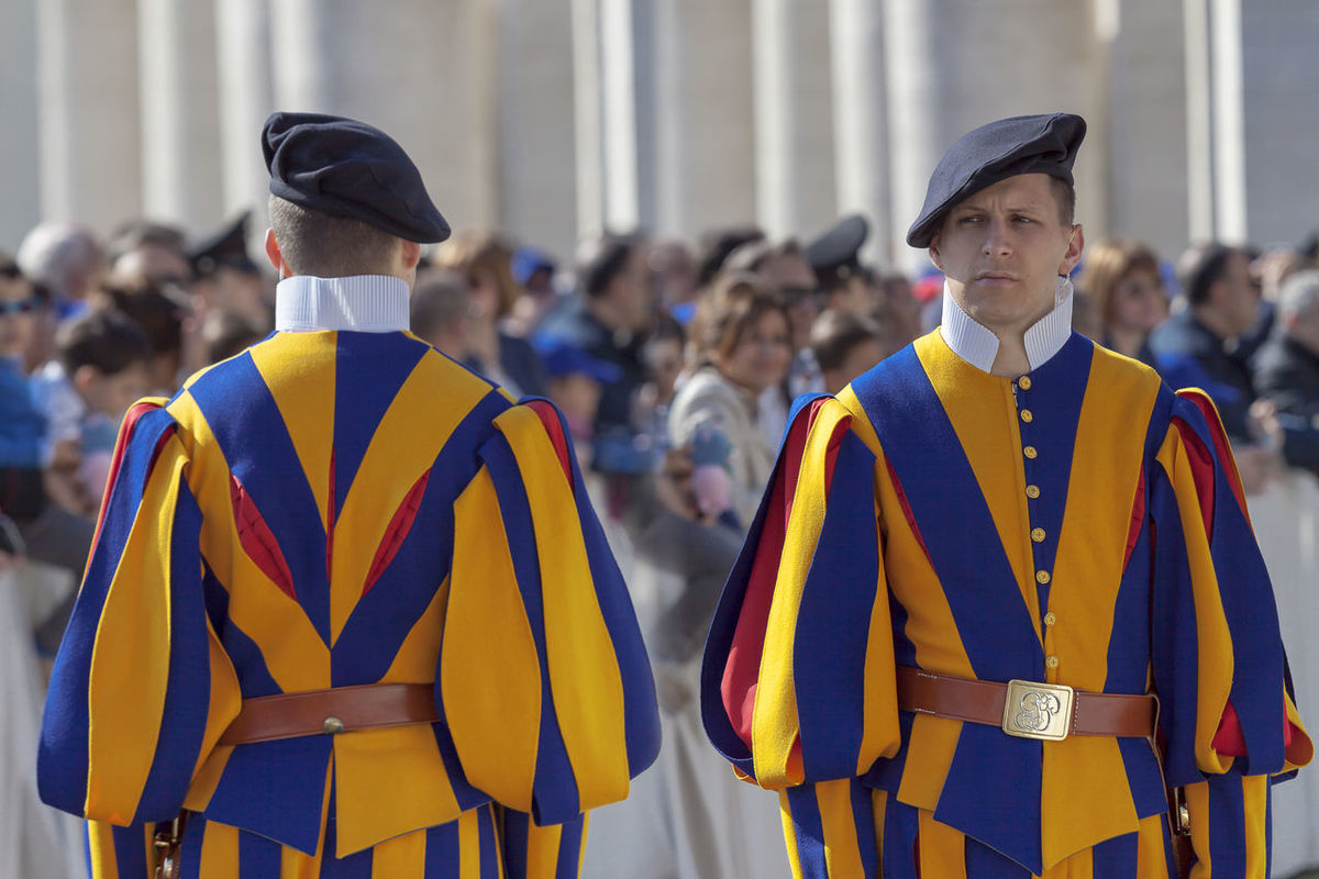 Rome, Italy - April 30, 2016: Swiss Guards, with their colorful uniform feature, lined up in St. Peter's Square, in the general audience of the Pope. Lifestyles Multi Colored Outdoors Special Striped Swiss Guard The Military Body The Pope