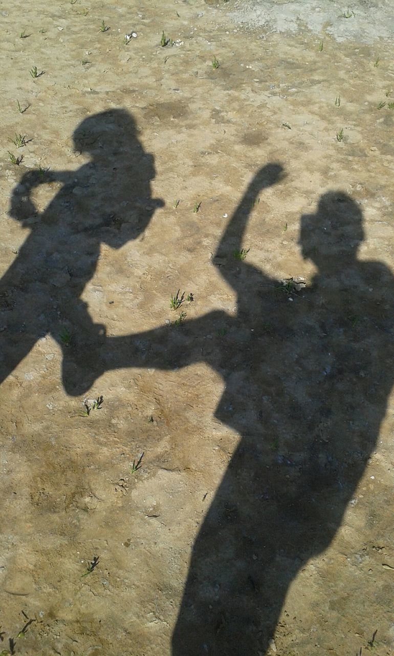 shadow, sunlight, focus on shadow, real people, high angle view, day, outdoors, standing, togetherness, men, nature, people