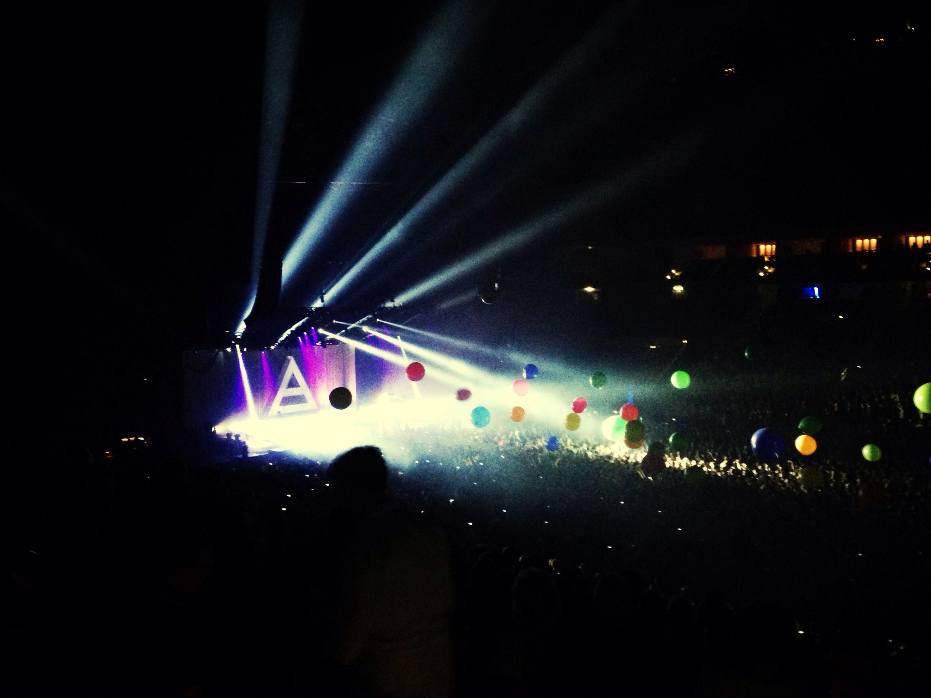 illuminated, night, large group of people, nightlife, crowd, arts culture and entertainment, music, event, person, performance, stage - performance space, light - natural phenomenon, lighting equipment, lifestyles, leisure activity, men, celebration, stage light, concert