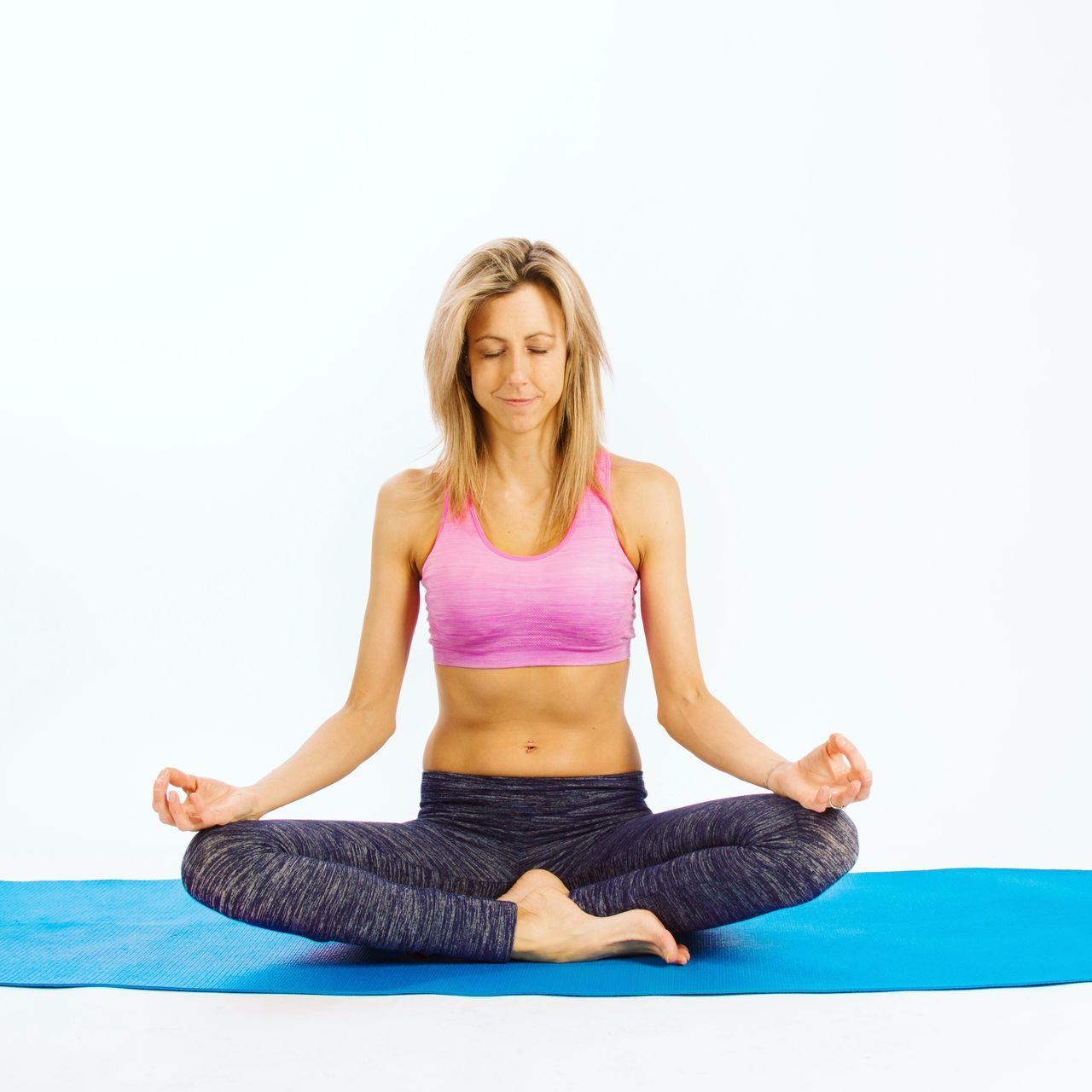 Serene yoga. Yoga Cross-legged Healthy Lifestyle Meditating Zen-like Studio Shot Lotus Position Sitting Wellbeing Blond Hair Full Length Serene People Relaxation One Person Lifestyles One Woman Only Women Flexibility Beautiful Woman Adult