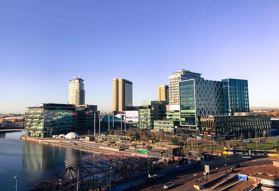 MediaCity UK. Salford Quays. Finding New Frontiers Building Exterior Architecture City Built Structure Skyscraper Clear Sky Outdoors Modern No People Travel Destinations Urban Skyline Day Water Mediacityuk Salford Quays Urban Landscape Cityscape Sky Modern Architecture IPhone7Plus Urban Cityscape Buildings & Sky Architecture Photography