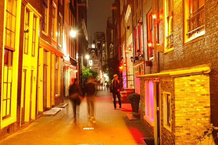 Amsterdam Red Light District Night Illuminated Building Exterior Architecture Built Structure Walking Street City Outdoors Men Real People People