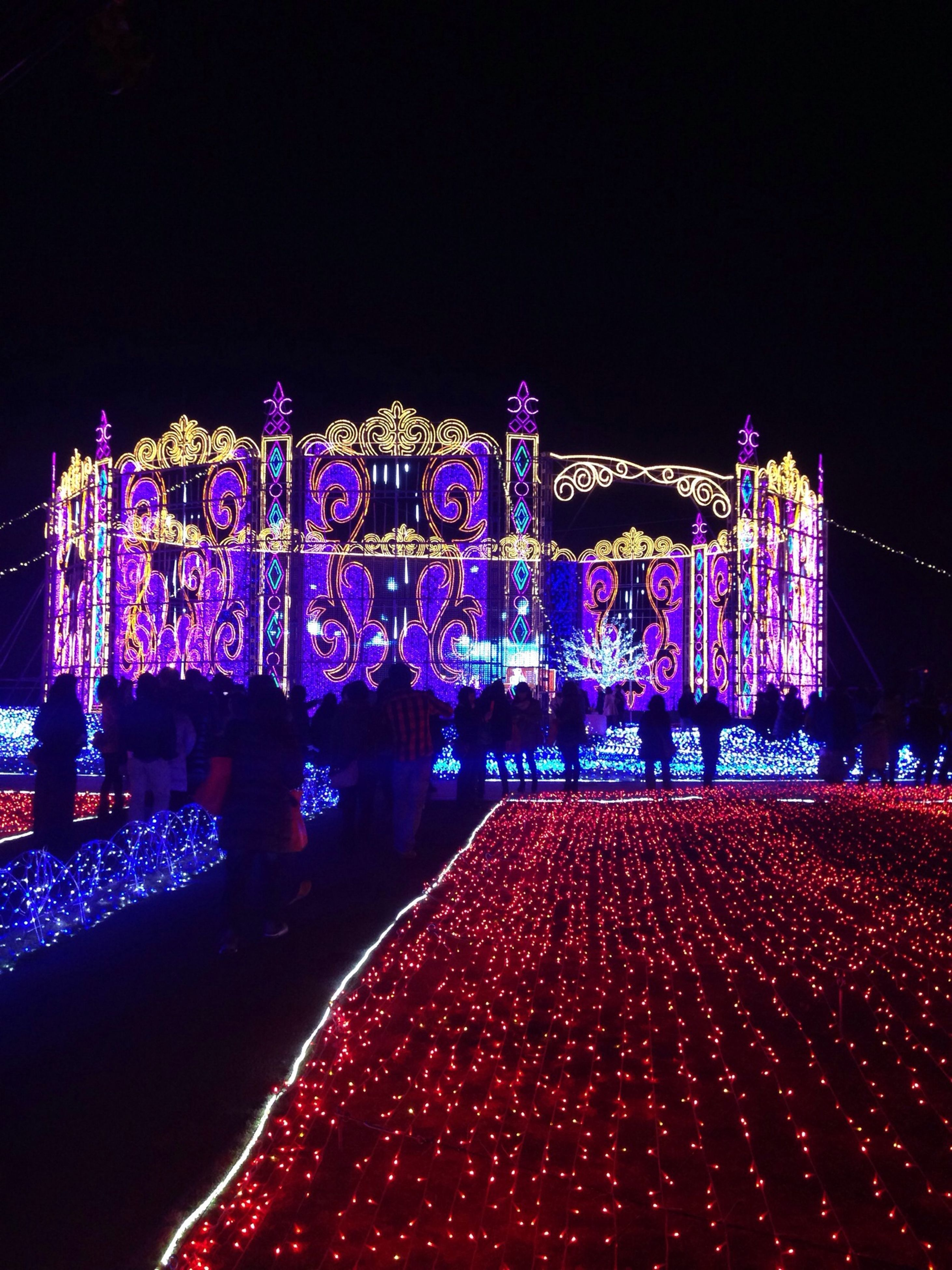 night, illuminated, clear sky, copy space, leisure activity, lighting equipment, multi colored, city, built structure, building exterior, architecture, dark, lifestyles, men, large group of people, celebration, outdoors, arts culture and entertainment, light - natural phenomenon
