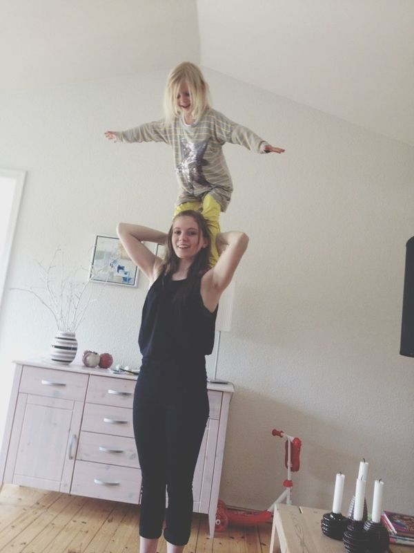gymnastics with my sister in the livingroom