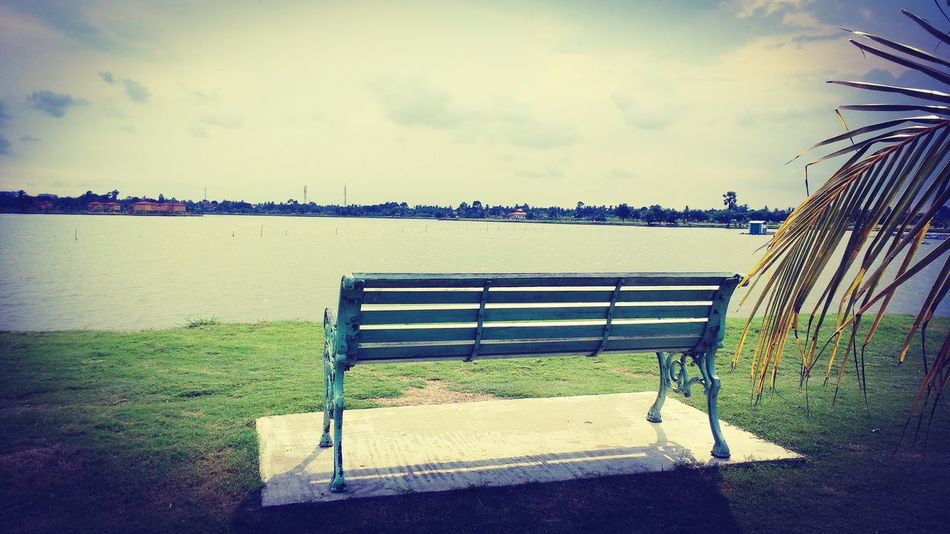 Empty Sky Water Bench Outdoors Grass No People