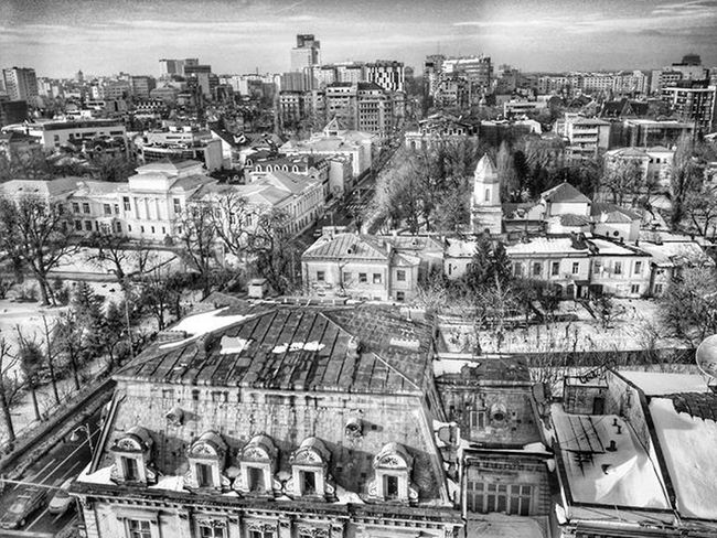Sin city Romania Romaniafrumoasa Bucharest January Afternoon Rooftop View Awesome Sin  City Blackandwhite Streetphotography Photooftheday Grey Instapic Instagood Instagram Urban Architecture Victoriei Tulip Hotel Samsung S4S Snapseed freedom freezing melt snow enjoybucharest