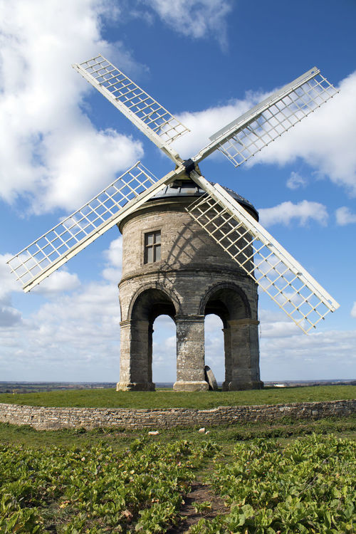 Chesterton 17th-century cylindrical stone tower windmill against a blue sky with clouds. Chesterton, West Midlands, UK Architecture Built Structure Chesterton Windmill Cloud - Sky Day Field Nature No People Outdoors Rural Scene Sky Traditional Windmill Wind Power Wind Turbine Windmill