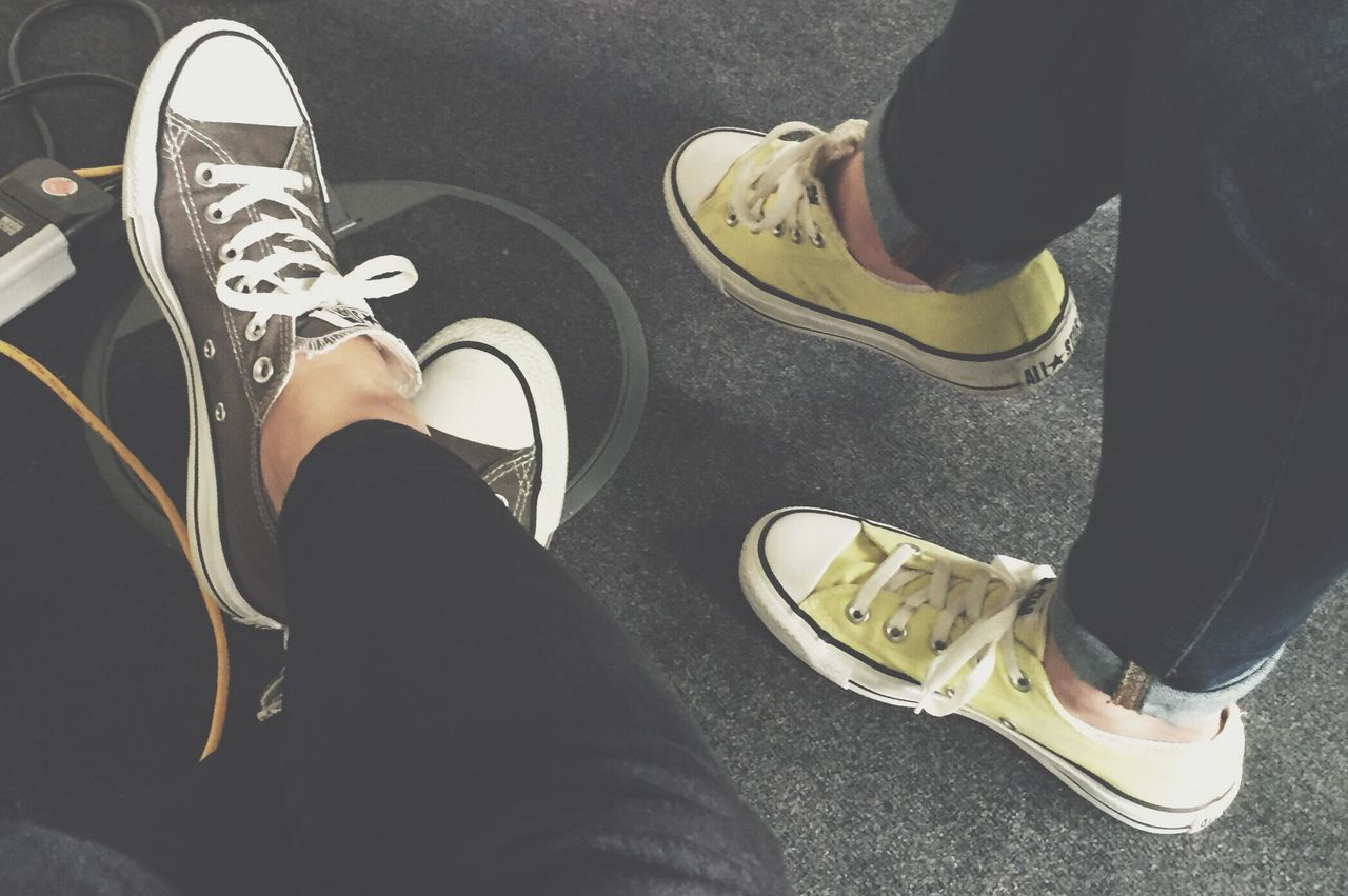 Out Of The Box Chucks Love Low Section Human Leg Shoe Human Body Part High Angle View Human Foot Canvas Shoe Real People Personal Perspective Two People Lifestyles Leisure Activity Sitting Indoors