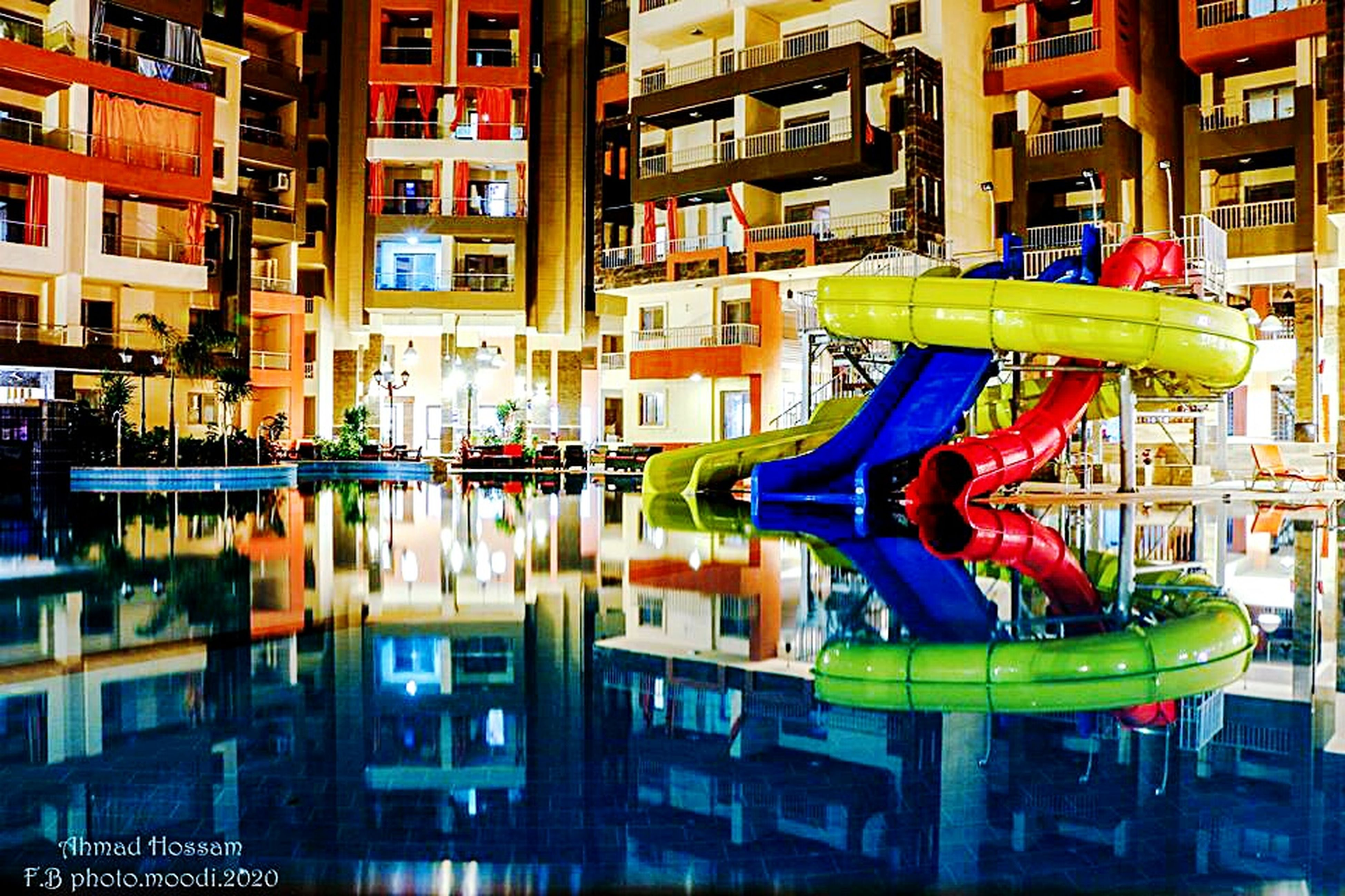architecture, building exterior, built structure, multi colored, city, building, residential building, residential structure, outdoors, colorful, day, city life, no people, modern