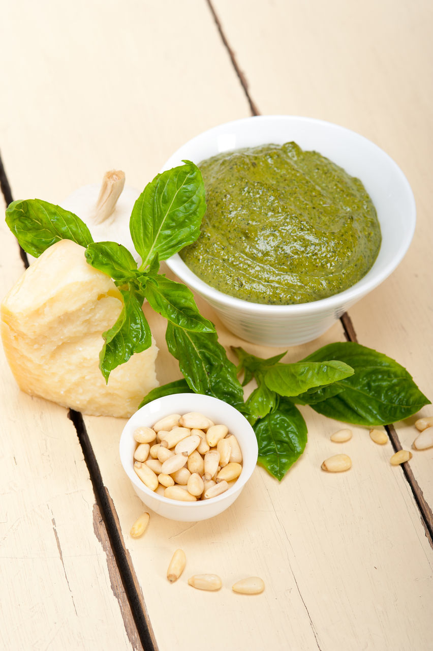food and drink, pine nut, freshness, wood - material, ingredient, basil, garlic, indoors, bowl, high angle view, pesto sauce, italian food, preparation, parmesan cheese, leaf, herb, healthy eating, no people, table, olive oil, vegetable, food, nut - food, close-up, mint leaf - culinary