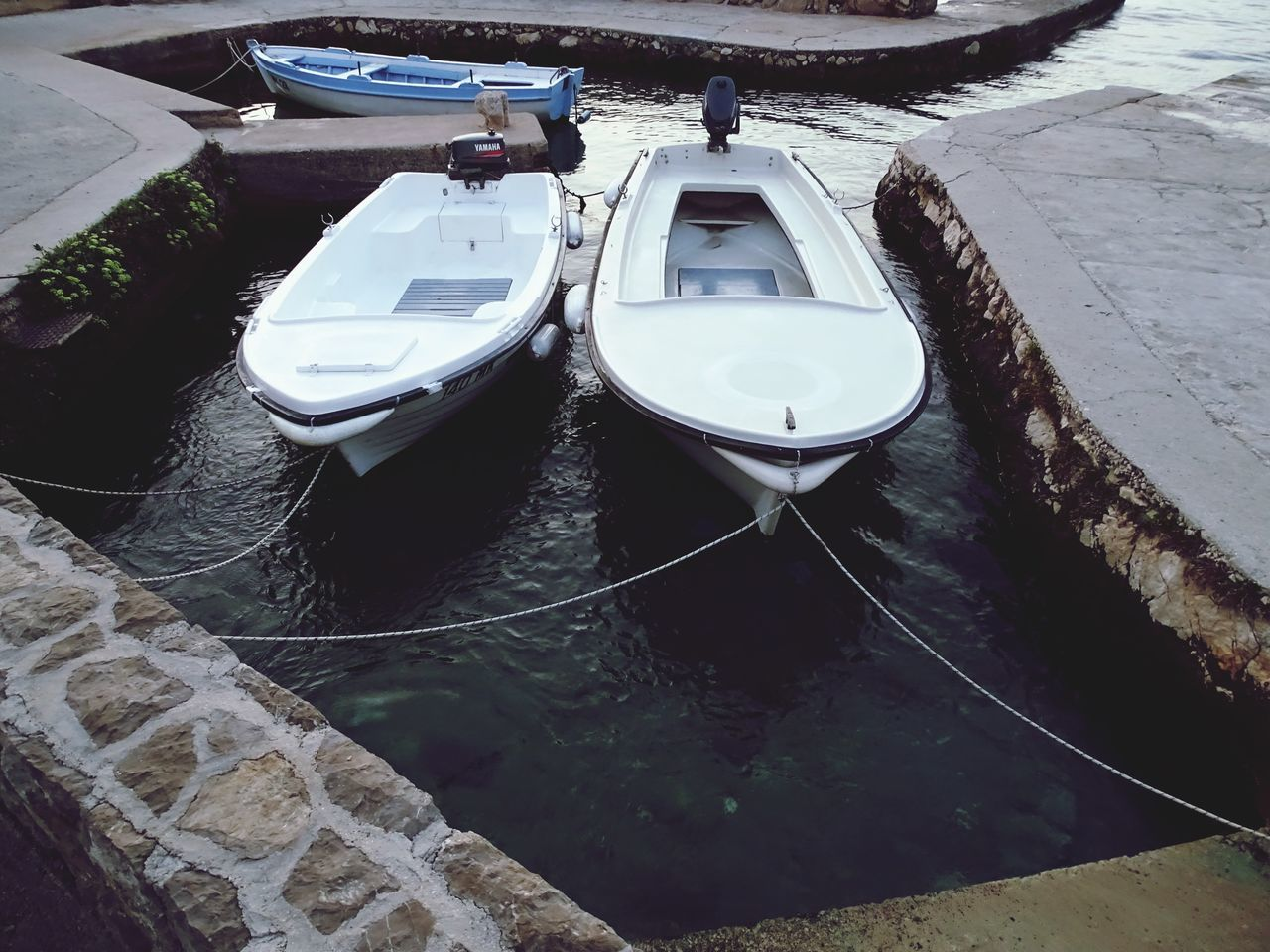High Angle View Of Boats Moored In Water
