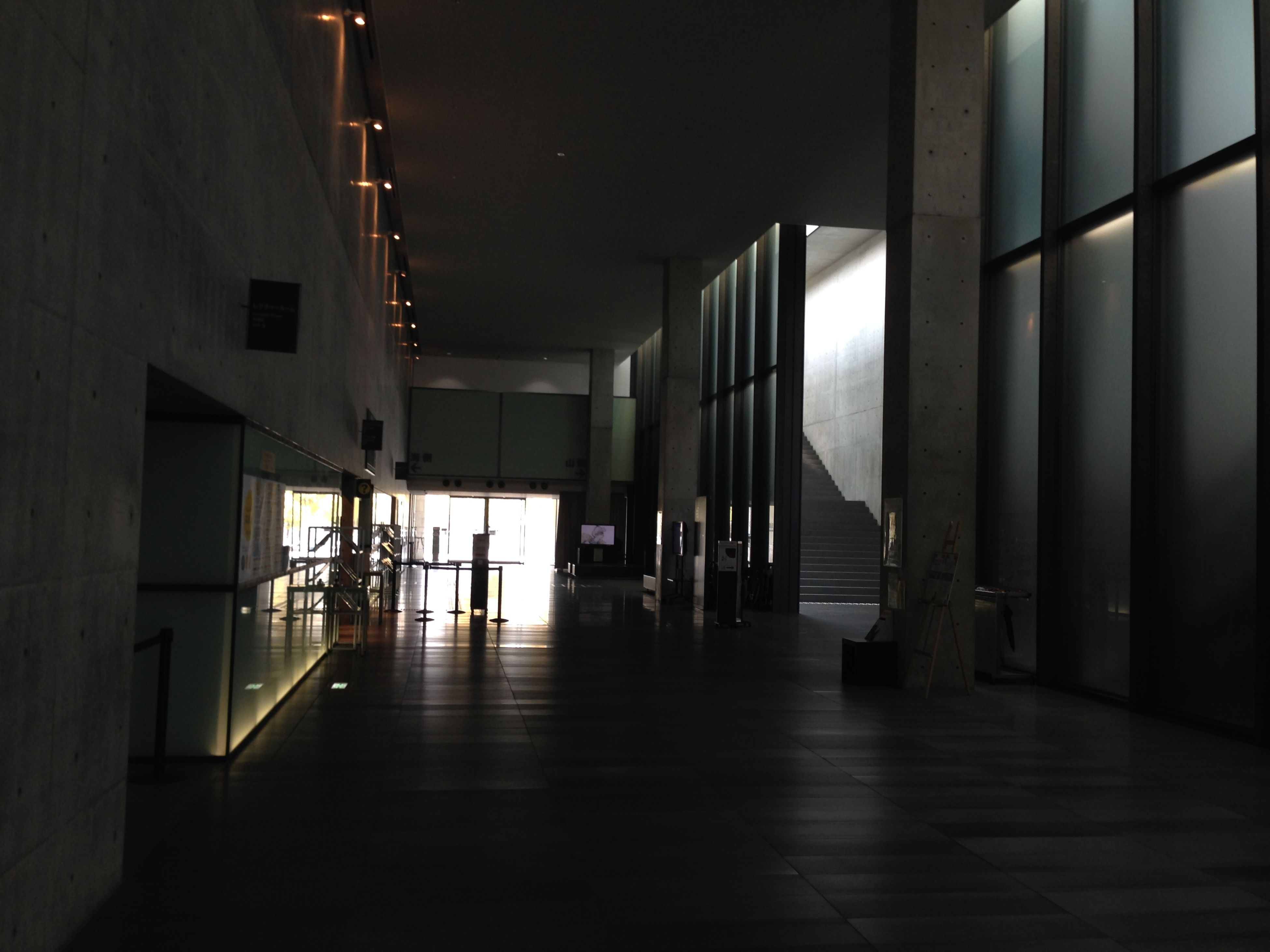 architecture, built structure, indoors, architectural column, corridor, column, the way forward, empty, flooring, building, building exterior, illuminated, diminishing perspective, modern, ceiling, long, city, support, no people, pillar