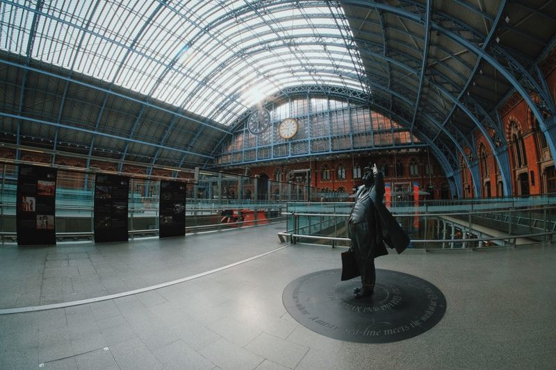 Architecture Built Structure Casual Clothing Ceiling Full Length Indoors  Leisure Activity Lifestyles Men Paddington Paddington Station Passenger Person Public Transportation Railroad Station Real People Rear View Sitting Standing Transportation Travel