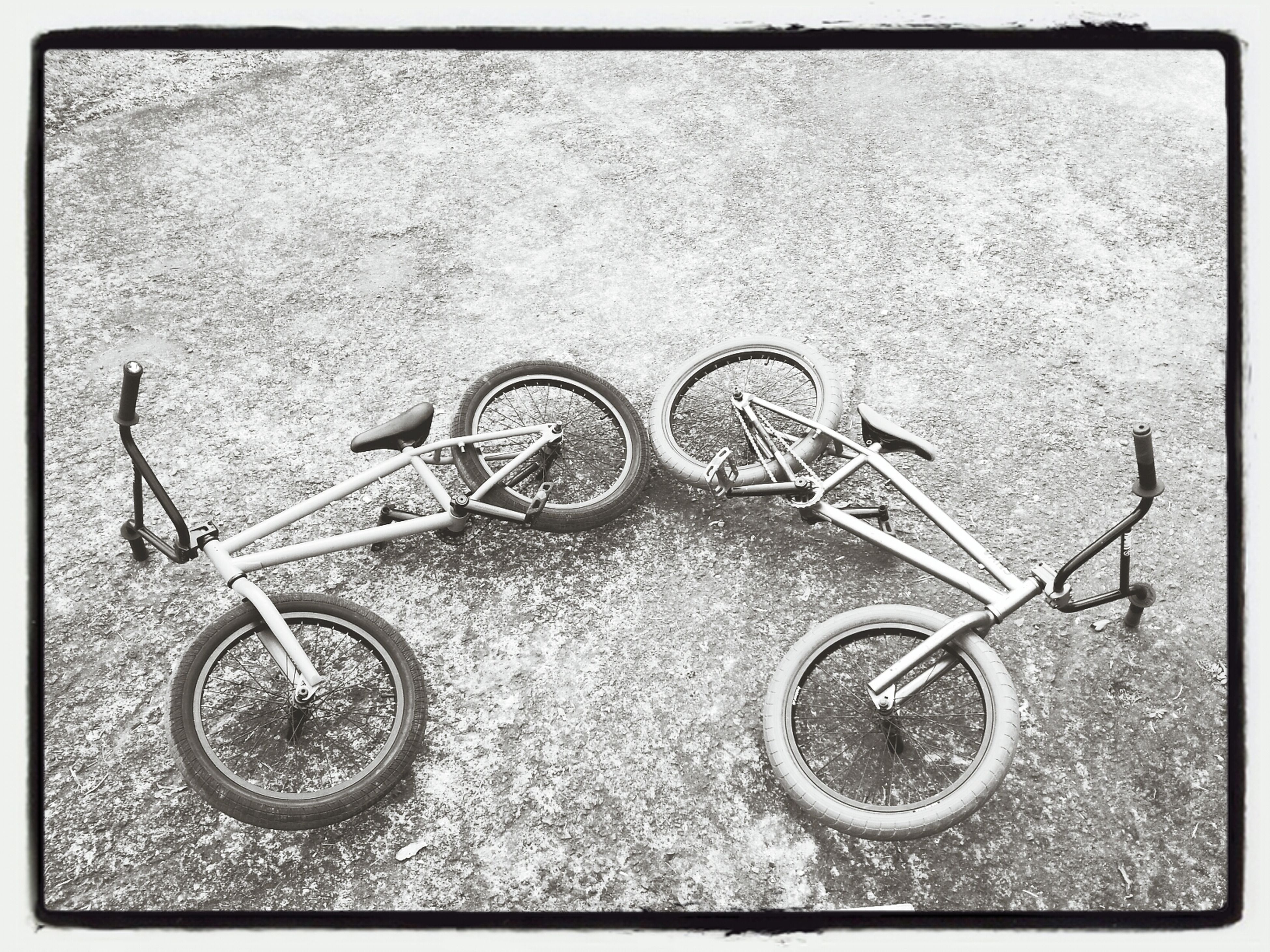 bicycle, transfer print, auto post production filter, metal, stationary, transportation, wheel, old, land vehicle, abandoned, parked, wall - building feature, mode of transport, no people, close-up, parking, high angle view, obsolete, retro styled, day